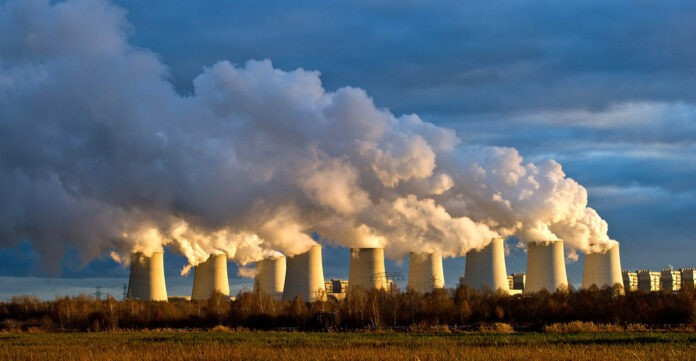 the setting sun illuminates cooling towers of a brown coal power station of the power company vattenfall in jaenschwalde, germany, 15 december 2011. the power station is the biggest of its kind with an output of 3.000 megawatt, according to vattenfall. 90